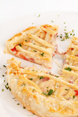 tasty quiche with cheese and herbs