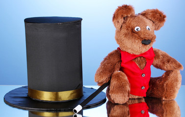 Bear and black cylinder on blue background.