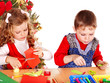 Children boy and girl making decoration card.