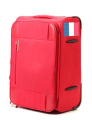 red suitcase with sticker with flag of France isolated on white