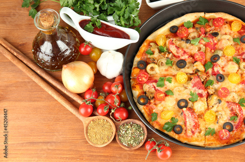 colorful composition of delicious pizza, vegetables and spices