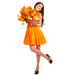 Woman holding orange leaves.