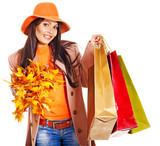 Fototapety Woman holding  orange leaves.