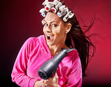 Fototapety Woman wear hair curlers on head.