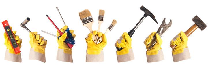Arbeitshandschuhe mit Werkzeug freigestellt