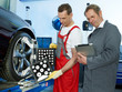 Master mechanic in a garage working with touchpad