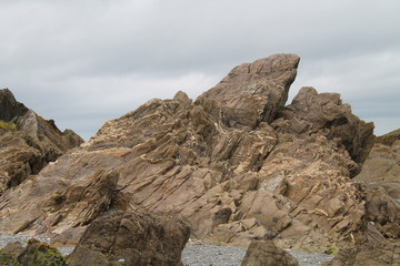 A Dramatic Rocky Outcrop on a Coastal Beach.