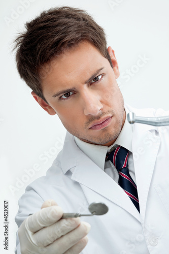 Dentist Holding Drill And Angled Mirror