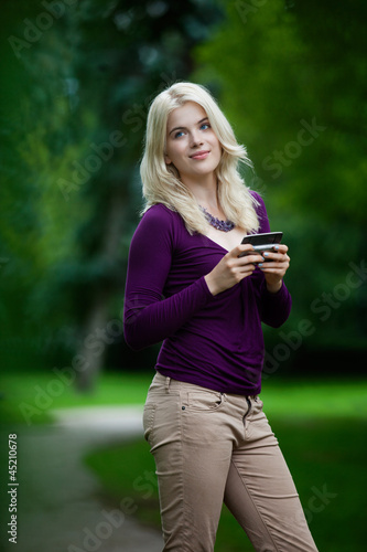 Woman Updating Status on Cell Phone