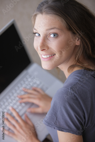 Beautiful woman surfing the net