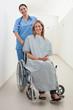 Happy nurse and patient in wheelchair