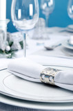 Blue and silver christmas table place setting with napkin