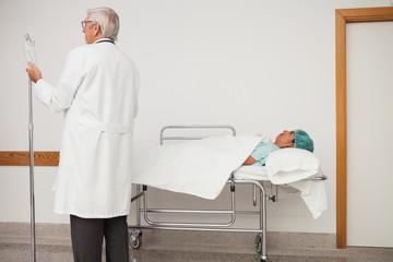 Doctor adjusting patients I.V drip