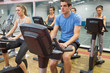 Spinning class riding on a exercise bikes
