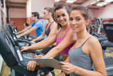 Gym Instructor and woman smiling