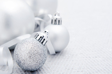 Silver christmas baubles with ribbon, plenty of copy space