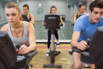 Five people at spinning class