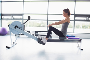 Woman working out on row machine