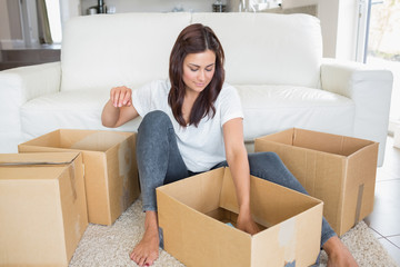 Woman looking into moving boxes