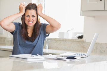 Woman getting frustrated over bills