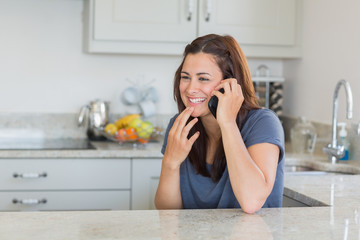 Brunette woman smiling and calling