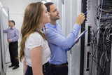 Technicians doing maintenance on servers