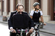Businessman and woman on bicycle
