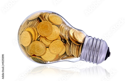 Traditional light glass bulb with many golden coins