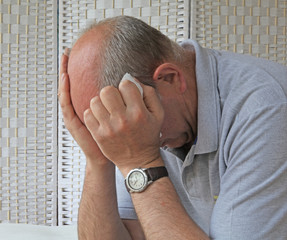 Depressed man holding tissue