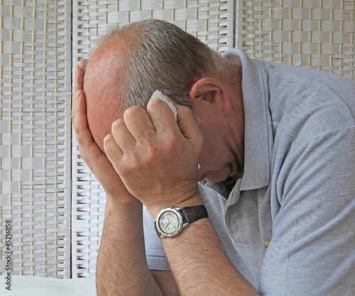 Depressed man holding tissue