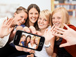 4 girls with self-portait on the smartphone
