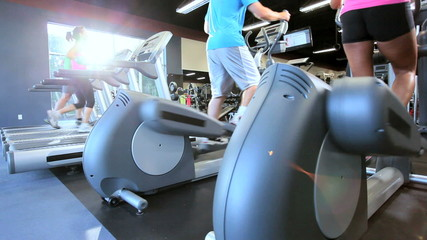 Exercising on Gym Treadmill