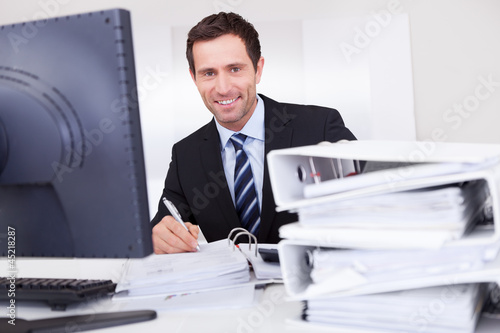 Portrait Of Happy Businessman