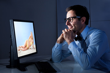 Portrait Of Businessman Looking At Computer