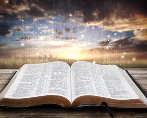 Glowing Bible at sunset