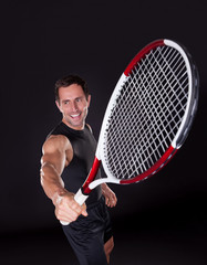 Young Man Holding Tennis Racket