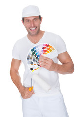 Painter Holding A Paint Roller And Spectrum