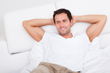 Portrait Of Young Man Relaxing On Bed