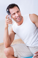 Young Man Holding A Bottle Of Water