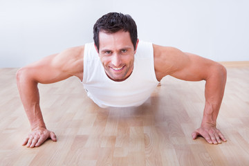 Young Man Performs Pushup