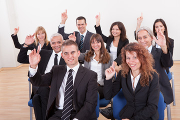 Business People Raising Their Hand