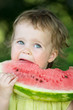 baby girl eating watermelon