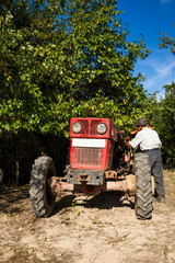 Senior farmer and his tractor