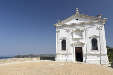 Church on hillside in Piran