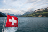 Swiss flag flutter above the lake