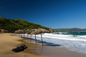 Straw umbrellas on a beach