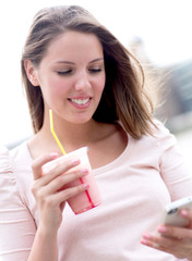 Woman enjoying a milkshake