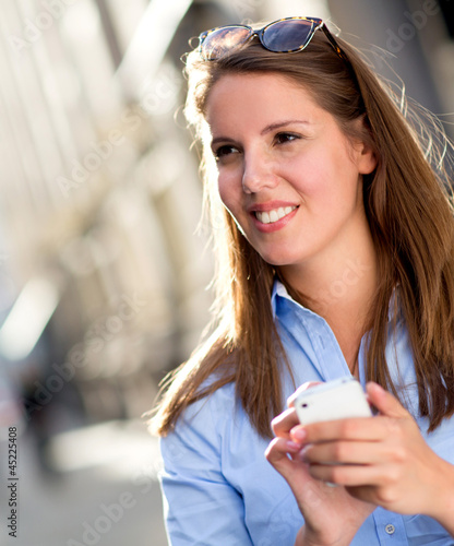 Woman holding her cell phone