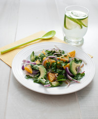 Red onion, avocado and oranges salad