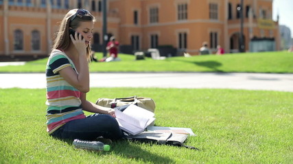 Female student talking on cellphone on campus